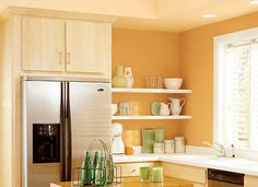 See top kitchen paint colors you can copy for your own kitchen from brands like Valspar, Sherwin Williams, Martha Stewart, and more.: Kitchen Paint Colors: Food-Themed Paint in a Kitchen. Grey Kitchen Cabinets, Painting Kitchen Cabinets, Cream Cabinets, Wood Cabinets, Kitchen Island, Orange Kitchen Walls, Orange Walls, Peach Kitchen, Green Kitchen