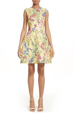 Captivating color brings full-blooming romance to the cocktail hour via this short and flouncy dress in a classically feminine silhouette of beautifully printed floral lace from Italy.