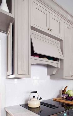Unique storage options in a traditional kitchen with gray cabinets