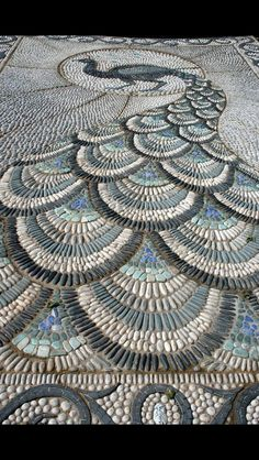 I suppose this should go in front of my fountain. Pebble mosaic pathway featured at the 2010 Chelsea Flower show. The peacock design is fantastic! Photo by Claire Ashman. Pebble Mosaic, Mosaic Art, Mosaic Glass, Rock Mosaic, Mosaic Walkway, Stone Mosaic, Tile Mosaics, Glass Tiles, Stone Tiles
