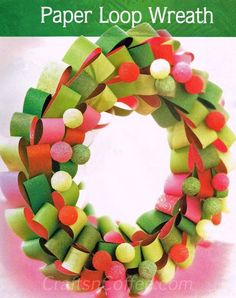 This Christmas wreath is so pretty and couldn't be easier. Paper loops are made from scrapbook paper, and the glittered balls add sparkle. Use a wreath of STYROFOAM Brand Foam for the base.