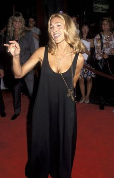 Pin for Later: 50 Times SJP Was a Real-Life Carrie Bradshaw  Telling it like it is in a minimal black tank dress and gothic cross necklace in '92.