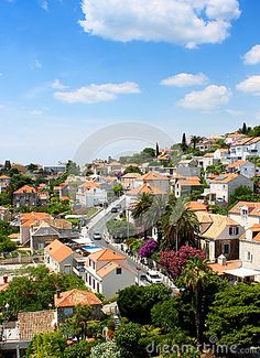 Photo about Bunch of houses from small town under the blue sky near Dubrovnik, Croatia. Image good for residential or travel banners, book or magazine cover. Image of town, buildings, small - 92246257 Croatia Images, Dubrovnik Croatia, Small Towns, Townhouse, Banners, Houses, Magazine, Stock Photos, Mansions