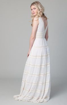 For the bohemian bride, this flowy, tiered dress features chiffon panels that keep it light and airy with delicate cotton lace embroidery. Perfect for