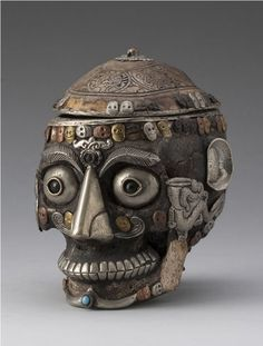 Tibetan skull bowl...because I wanna eat my chocolate chex out of a metal human head...seems legit.