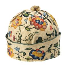 Man's cap, France, late 17th–early 18th century, linen embroidered with wool in stem, chain, and overcast loop stitches.