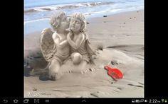 Angel kissing girl.