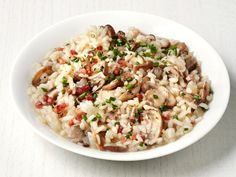 Get this all-star, easy-to-follow Mushroom and Pancetta Risotto recipe from Food Network Magazine.