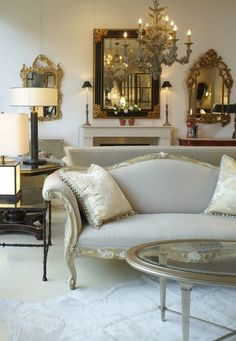 Gorgeous Living Rooms - Decorating with mirrors and lamps. This room would have a lovely warm glow at night