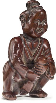 An erotic wood netsuke of Okame By the Deme family, Edo period (18th century)