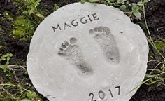 How to Make Footprint Garden Stones // Looking for the perfect Mother's Day gift? Check out how to make these cute footprint garden stones with these easy to follow DIY instructions.