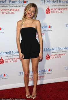 Cute for a cure: Kelsea Ballerini, 23, pulled out all the stops in a tiny black strapless jumper and glittery heels for the T.J. Martell Foundation's Music's Promise For a Cure