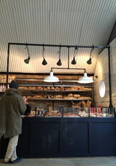 Fabrique Bakery   385 Geffrye St, E28HZ  This Swedish cafe does great coffee from Johan & Nystrom, accompanied by sugar sprinkled cinnamon buns. Much of the space is taken up with the production line, which turns out some excellent sourdough bread baked in stone ovens. Huge walnut boules and batons of ry are sold as whole or half loaves.