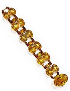 AN 18 KARAT GOLD, PLATINUM, CITRINE AND DIAMOND BRACELET, CARTIER, LONDON length 6½ in., signed Cartier, London, numbered 8492; circa 1940 Est. $25/35,000 View more of the property from the collection of Mrs. Paul Mellon   - TownandCountryMag.com