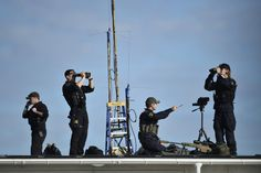Swedish police and army snipers are seen preparing on a roof at Arlanda Airport in Stockholm, Sweden. Swedish Police, Swedish Army, 29 September, Pictures Of The Week, Snipers, Military, Stockholm Sweden, Concert, Signs