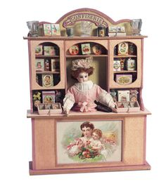 Miniature Confiserie with Poupee as Candy Box, circa 1885  The shop lifts off its base to reveal a hidden candy container base with compartment for doll and two large candy compartments. Luxury quality of the unique boite de bon-bons indicates its origin from prestige Parisian candy shop.