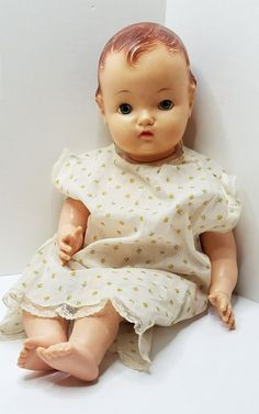 "Adorable 1950's Madame Alexander 23"" Floppy Baby Doll. She is marked Alexander on the back of her head. She has a hard plastic head with molded hair along with painted brows, lashes and lips. She has sleep eyes (one sits back a little occasionally) that have upper lashes. She features a closed mouth with blushy cheeks. Her hard plastic limbs with cute detailed fingers and toes. Her body is a floppy soft stuffed body. She shows normal signs of wear from use and age. Some discoloration..."