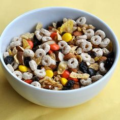 """1 cup corn flakes cereal                                          ¾ cup oat bran """"O""""s cereal (like Cheerios)                                          ½ cup almonds, coarsely chopped                                                                                                                         1/4 cup Reese's Pieces                                          ½ cup raisins"""