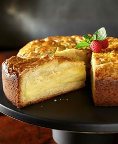 This French-inspired cake is filled with a rich amaretto custard. Serve at room temperature to best enjoy this creamy and decadent dessert recipe.