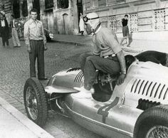 Tazio Nuvolari climbs out of his Auto Union after winning the Belgrade Grand Prix