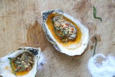 These BBQ grilled oysters are topped with an addictive chipotle bourbon butter, inspired by the version at Hog Island Oyster. They're also great broiled!