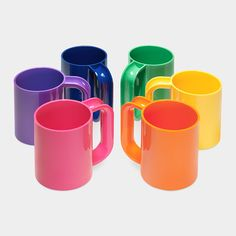 OMG they are back!  These were our family dishes when I was a kid... until the microwave came around (not micro safe).  MOMA has the old Heller Rainbow Mugs!