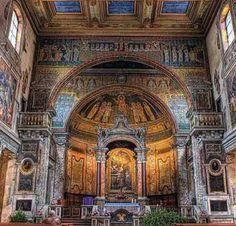 La basilica di Santa Prassede probabilmente sorge su un titulus Praxedis . Prassede e Pudenziana sono sorelle e fìglie di Pudente, discepolo di Paolo. Secondo notizie agiografìche risalenti al V se…