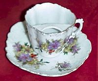 Moustache Cup    A great deal of fine china was produced in Victorian times.    This particular cup and saucer would be used by a rich gentleman.    Moustaches were very fashionable in Victorian times and the bar across the top would stop the gentleman's moustache from getting wet!