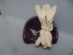 Rabbit Couple on Deep Purple Couch now available email harry@harryleaf.com $32 plus shipping.