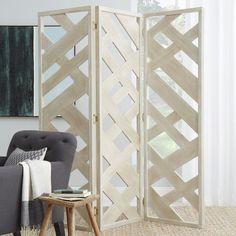 The Abstract Fretwork Screen brings home the beach with a modern twist. The uneven pattern and natural finish was inspired by sun-bleached driftwood. Use it as a room divider or behind a sofa. When not in use, it can be folded up and stored away.