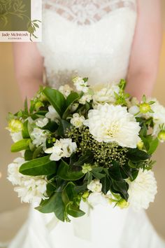 White and green! Kate's slightly unstructured posy features green cymbidium orchids, white dahlias, hyacinth, winter green hydrangea, freesia, viburnum foliage and ivy berry. www.jademcintoshflowers.com.au