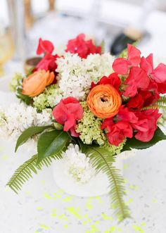 orange and red ranunculus centerpiece  | Photos by Birds of a Feather | 100 Layer Cake