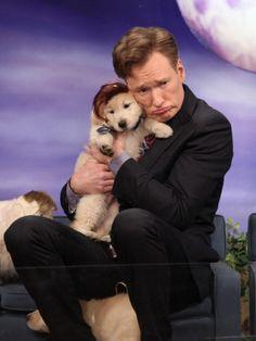 Conan Cuddles With Puppy Conan