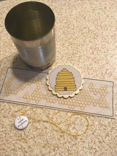 Working on my cross stitch honeycomb to wrap around the can...