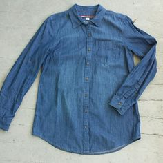 "Longsleeve denim button down tunic Perfect condition long sleeve denim tunic length button down collared shirt. 1 front pocket. Darting at bust for a feminine fit. 100% cotton. Tommy Hilfiger. Size medium. Appx measurements laid flat: armpit to armpit 18"", shoulder to hem length 28"". Tommy Hilfiger Tops Button Down Shirts"