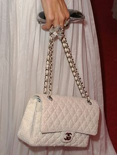 Ivory Extra, Rachel Zoe accents an all-white outfit with, what else, a white fabric Chanel.