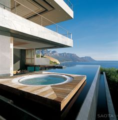 This is an excellent use of an infinity pool. I like how the hot tub ends up looking like a raft floating in the pool. Moderne Pools, House By The Sea, Dream Pools, Cool Pools, Awesome Pools, Pool Designs, Outdoor Pool, Outdoor Baths, Backyard Patio