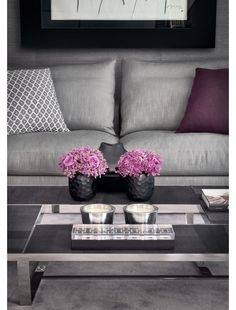Silver and purple lounge, oh my. I might go for a white sofa instead, this would probably look cold. Maybe some orange or yellow accents would help.