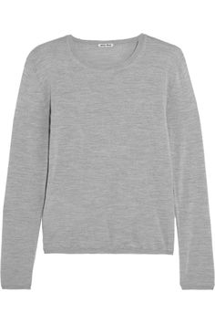 Miu Miu|Cashmere and silk-blend sweater|NET-A-PORTER.COM Miu Miu's gray sweater is the perfect year-round staple. Knitted from the finest cashmere, it's also spun with silk for softness. Wear yours with a pencil skirt for the office, switching to printed shorts or skinny jeans on weekends.  Gray cashmere and silk-blend Slips on 70% cashmere, 30% silk Dry clean
