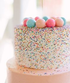 rainbow sprinkle cake with gumballs - great for birthday or baby shower!