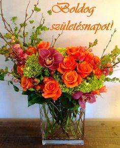 flower arrangement of orange roses, green hypericum… Green Bouquet Floral Design; flower arrangement of orange roses,.