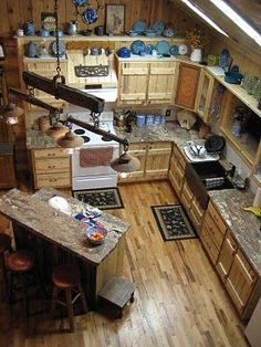 Rodeo Tales & Gypsy Trails: Ranch House Style, a saddle makers home decor Love this kitchen!! Matches layout if kitchen. Like sink and format for kitchen remodel just not western design