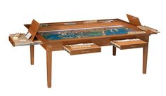 A 4' x 6' (interior size) cherry Emissary with a full set up of Axis & Alies on it. For dining and gaming.