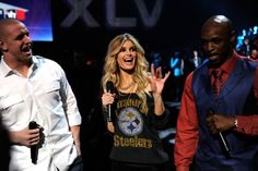 NBA player James Laurinaitis model Marisa Miller and NBA player Reggie Wayne onstage during VH1's Pepsi Super Bowl Fan Jam at Verizon Theater on...