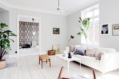 Neutral, light-filled living space with soft palette of pillows
