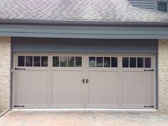 C h i carriage house collection model 5983 in sandstone for 18 x 7 garage door