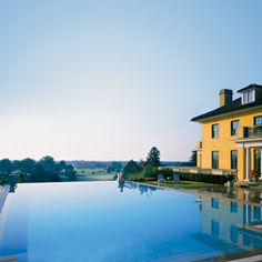 Keswick Hall at Monticello, Charlottesville, VA: Set on 600 acres in Jeffersonian wine country, Keswick's 25-meter infinity pool mirrors the rolling footlhills of the Blue Ridge Mountains.