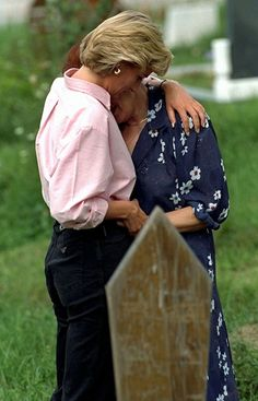 Diana, Princess of Wales comforts the relative of a person killed by a landmine in Sarajevo, Bosnia. (Aug 10, 1997)