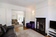 through lounge with victorian fireplace
