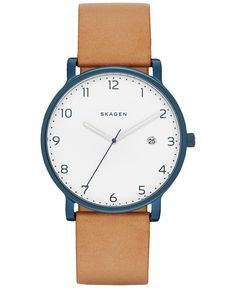 Crisp blue numerals stand out against a white sandblasted dial on this sleekly designed Skagen watch. | Bone leather strap | Round blue ion-plated case, 40mm | White sandblasted dial with blue Arabic